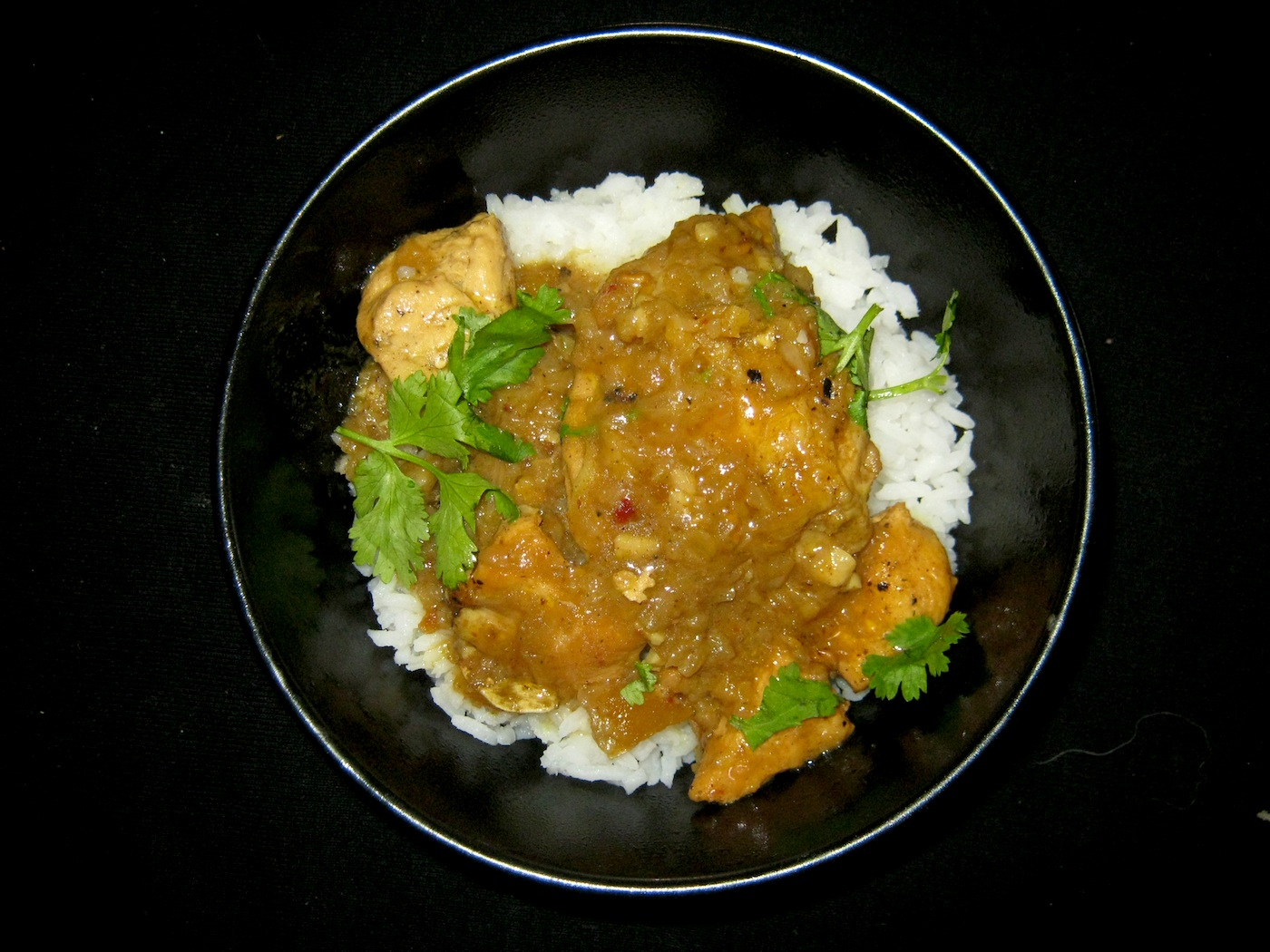 Chicken korma in black bowl