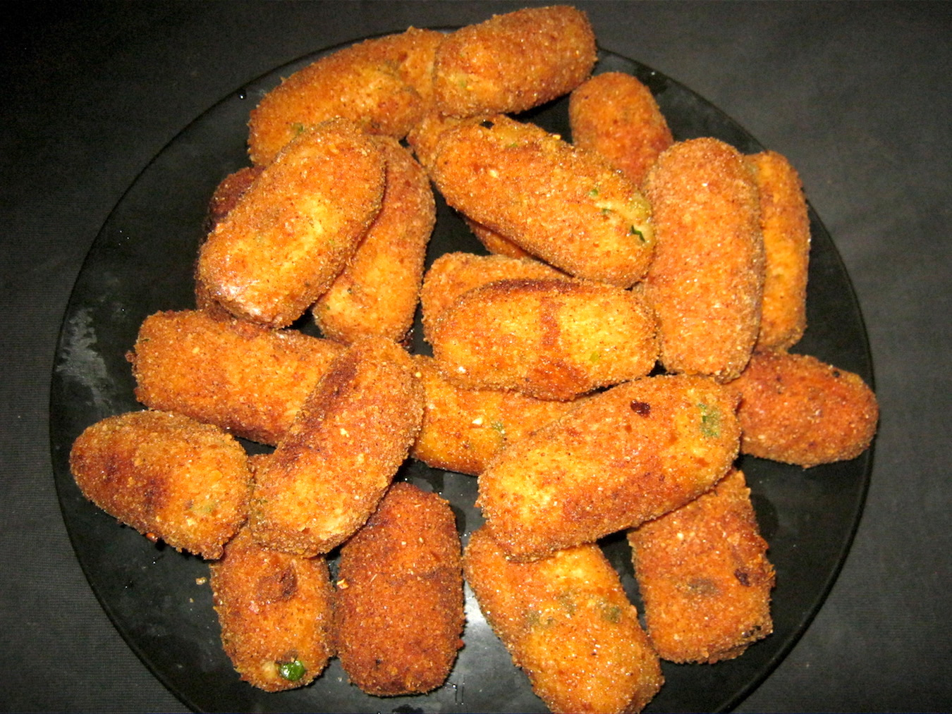 Dutch chicken croquettes on black plate