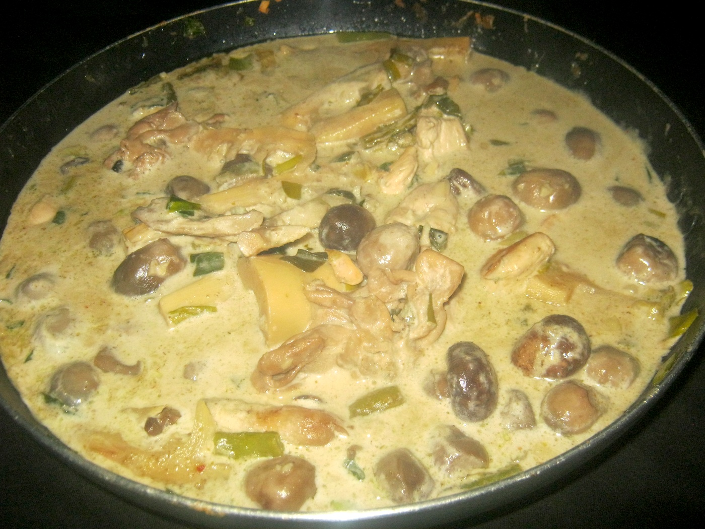 Thai green chicken curry in pan