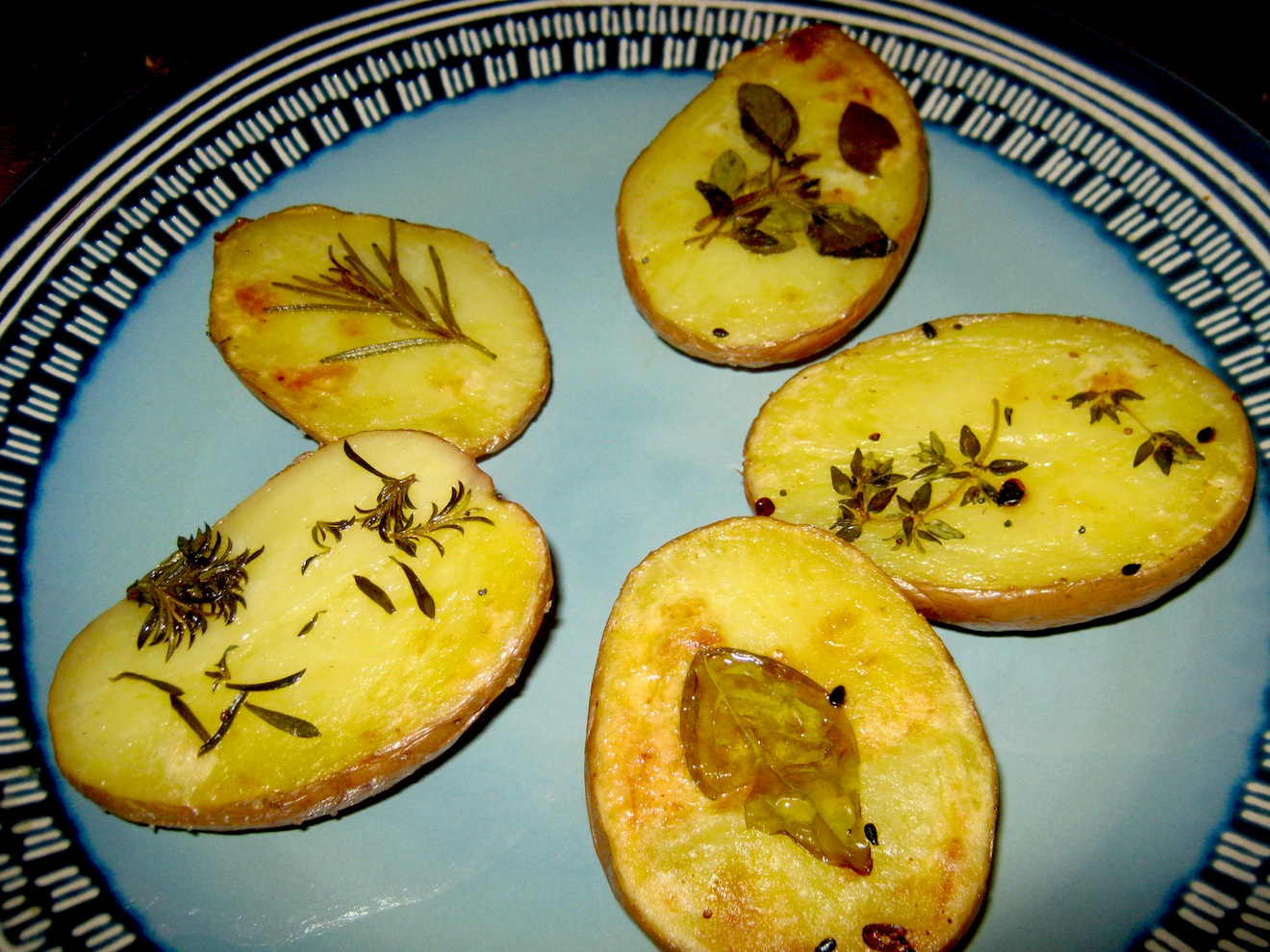 Baked Herb Potatoes on a blue plate