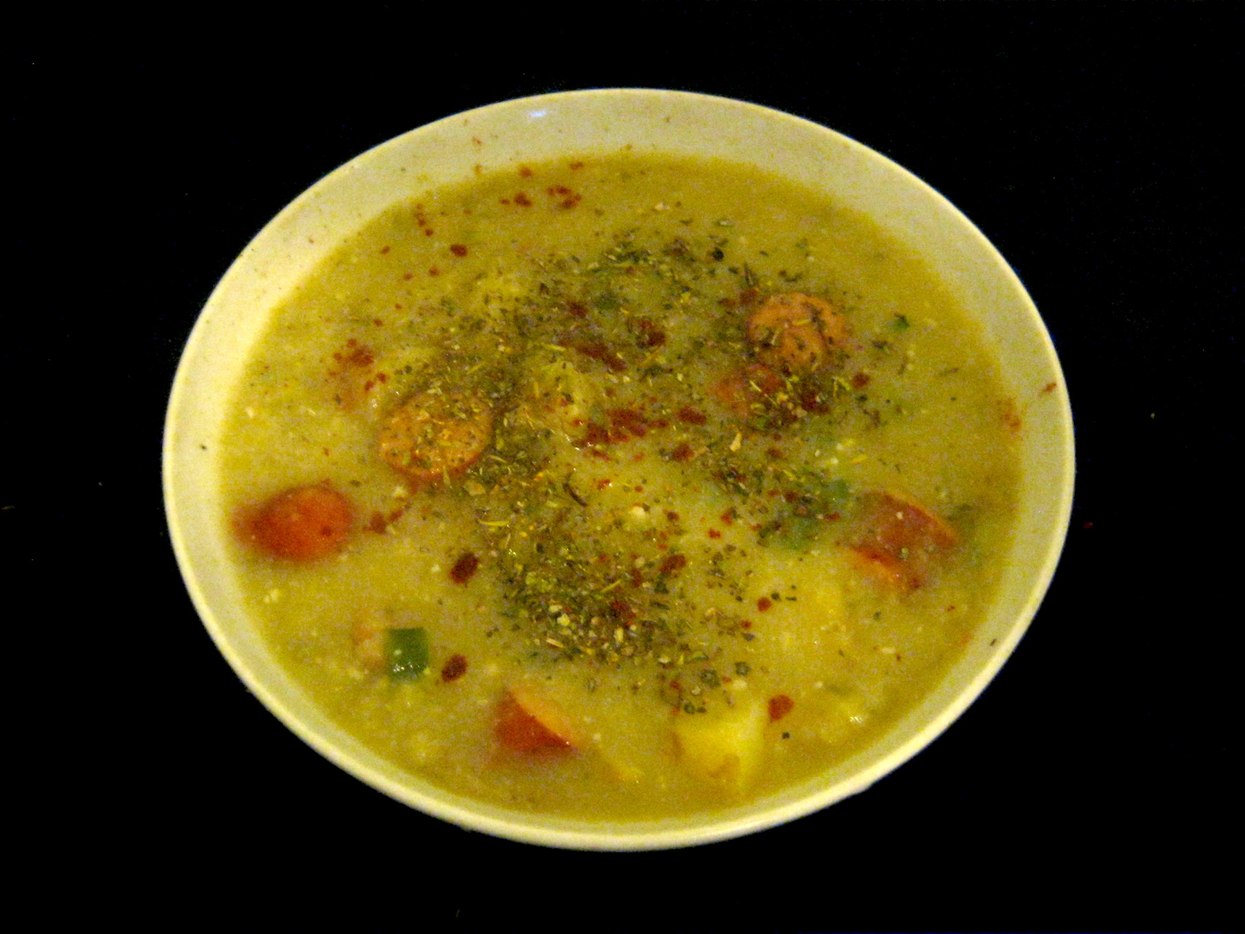 Potato leek soup with Debrecziner in a white bowl