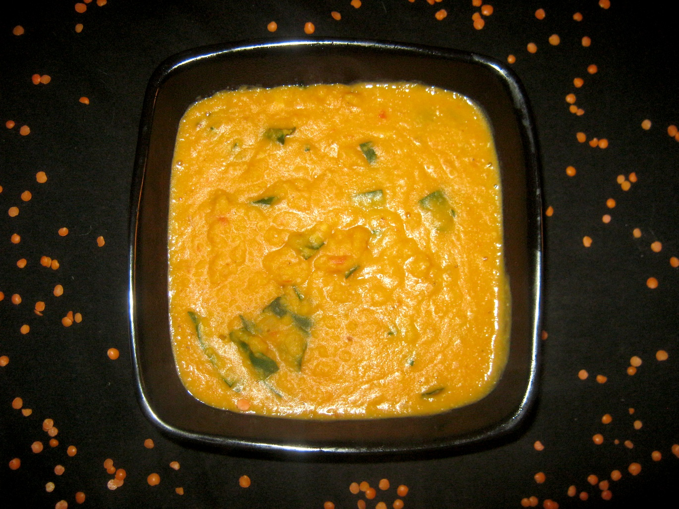 Red lentil soup with coconut milk and chard