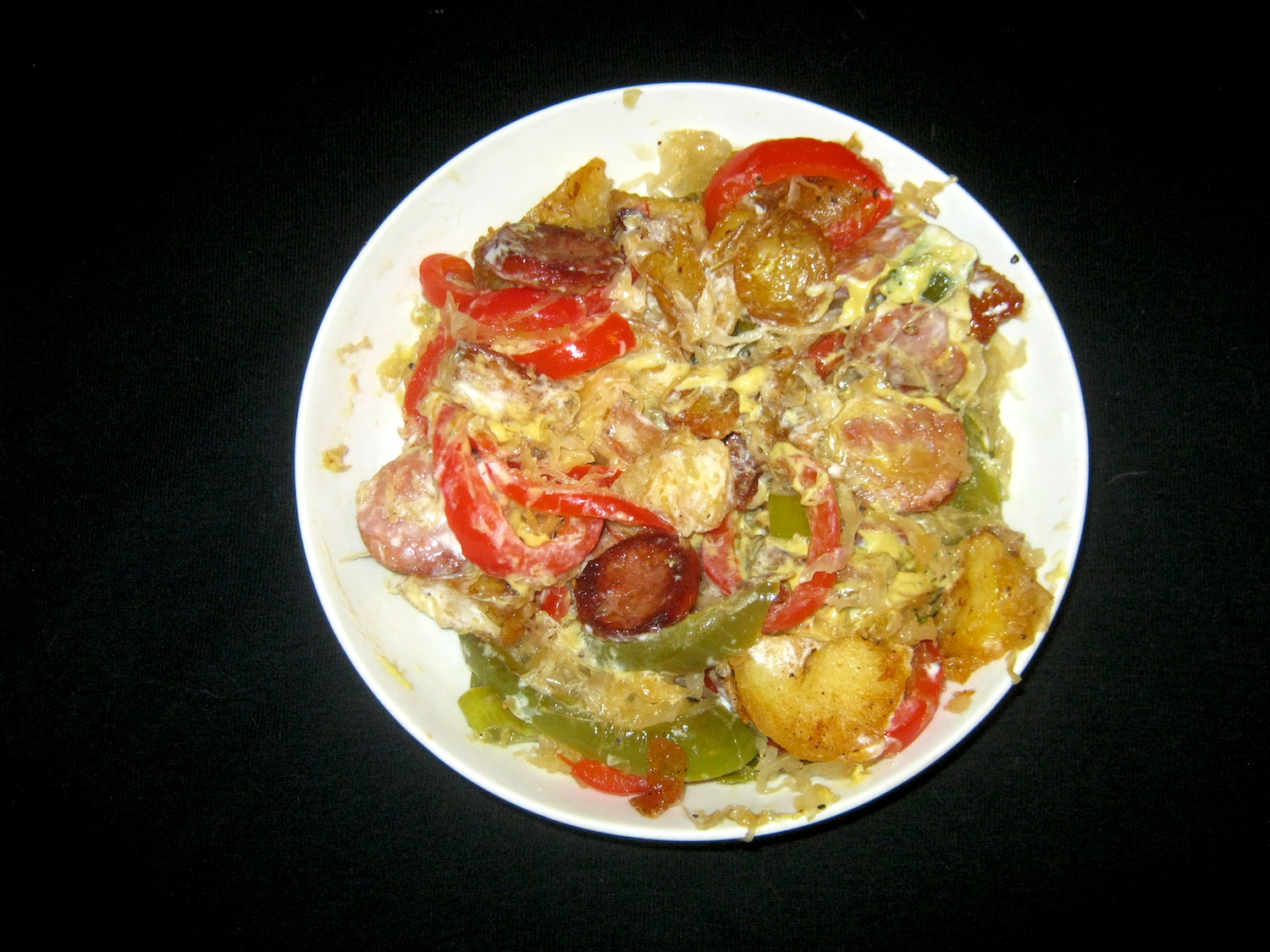 Sauerkraut and smoked sausage with sweet peppers and spring onions in a yoghurt, butternut and mustard sauce