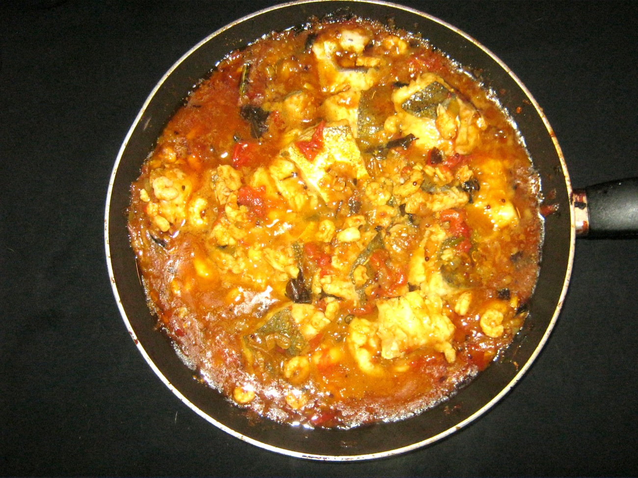Andhra Fish Curry in a pan / skillet