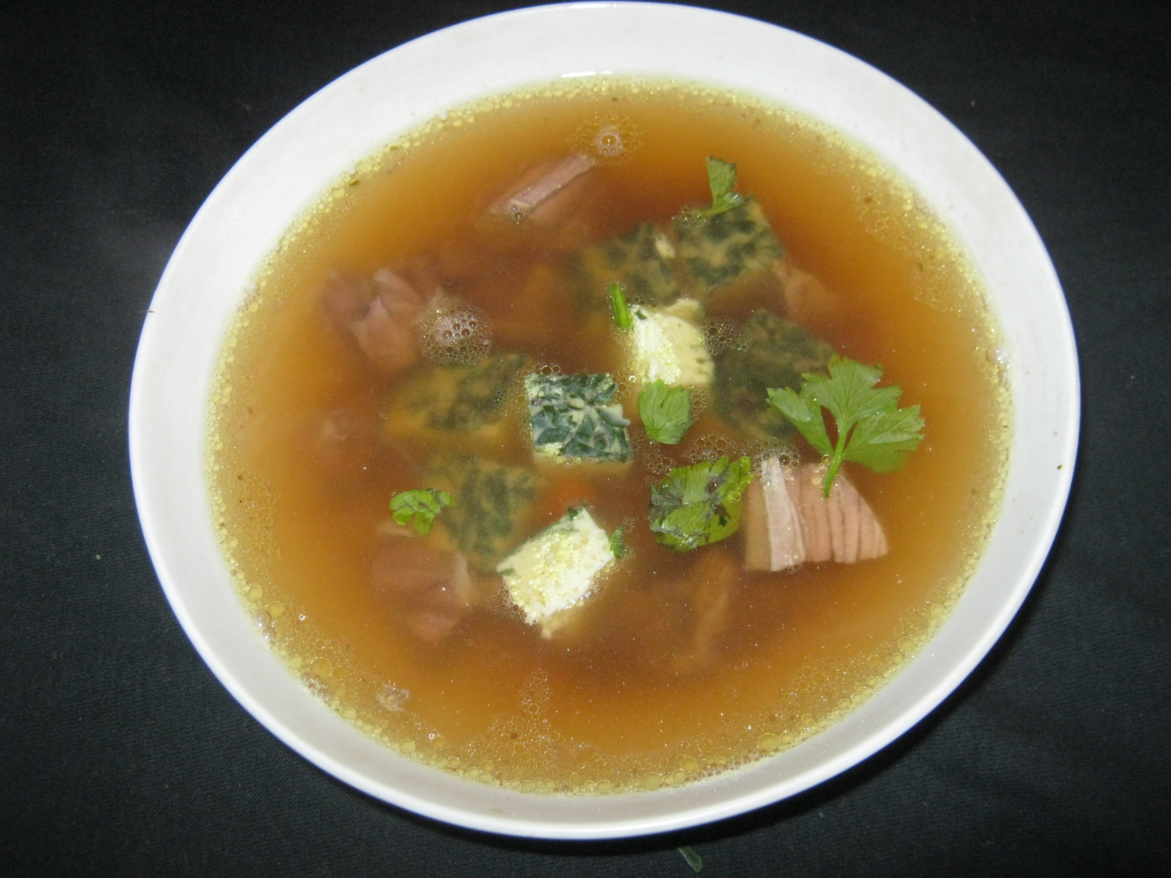 Find this clear meat broth with green Eierstich and other German recipes