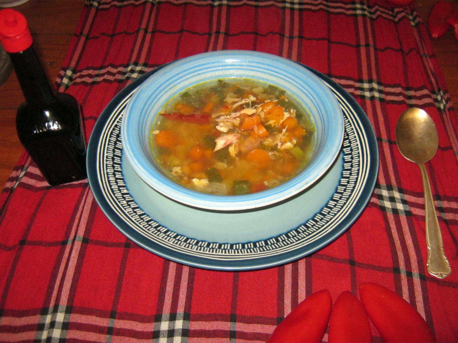Spicy and tasty chicken soup recipe from Germany with veggies and fresh herbs