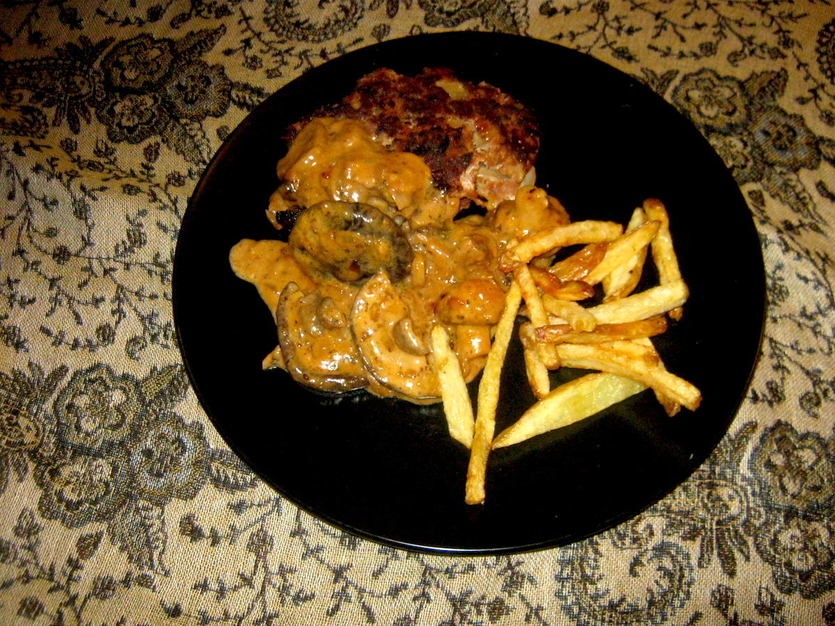 Traditional German Hunter sauce (Jägersauce) with a meatball and crispy chips.