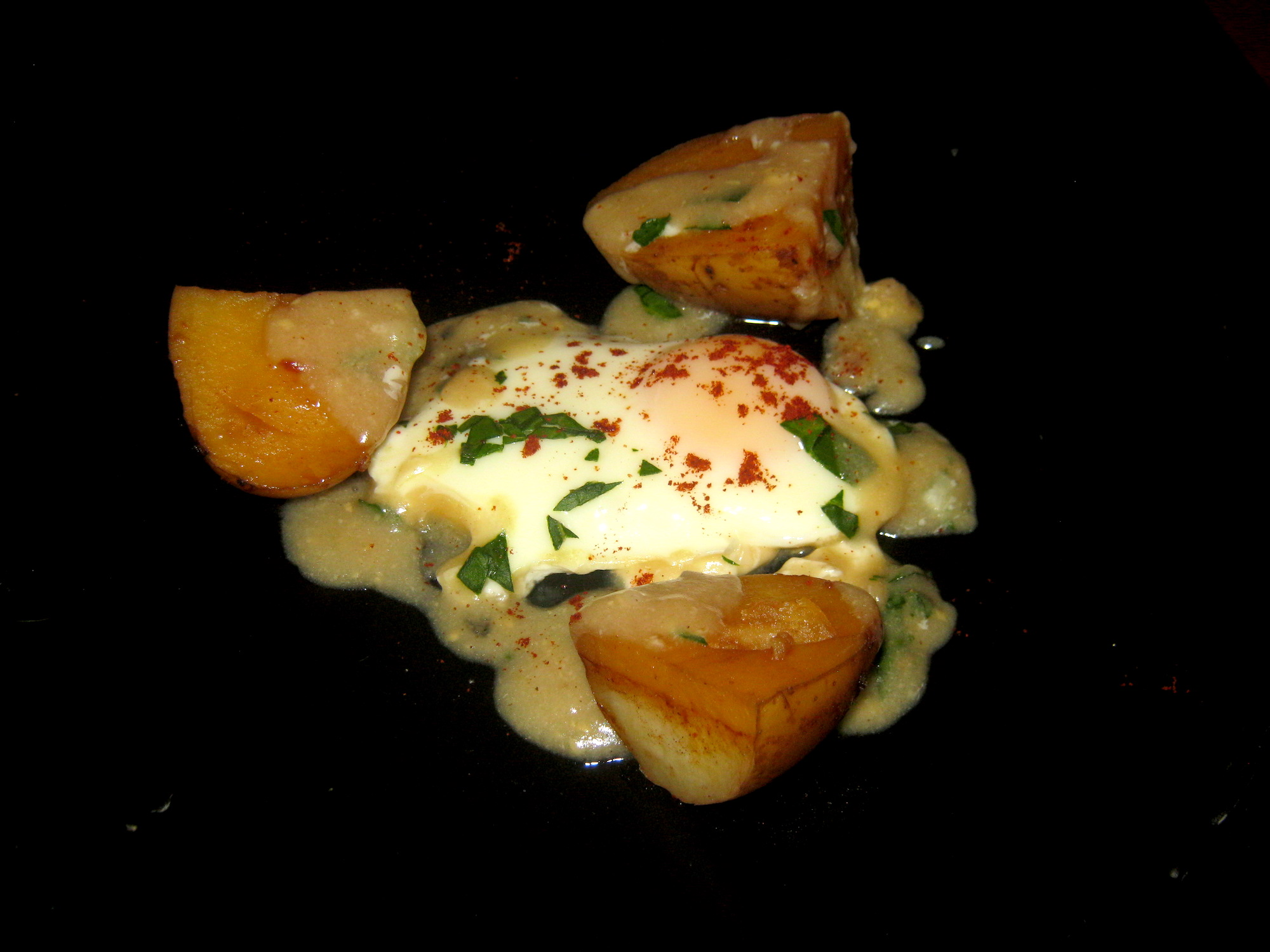 Sour eggs with fried potatoes and gravy on a plate