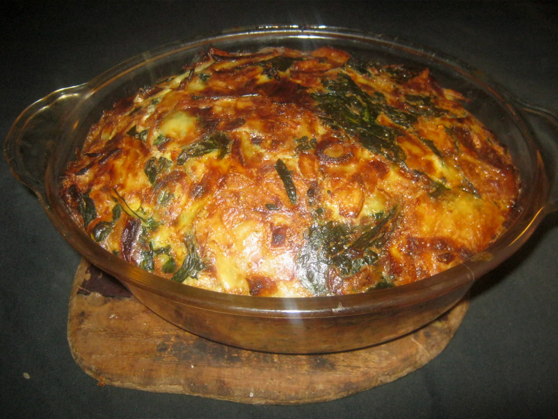 Spanish omelette with spinach in casserole dish