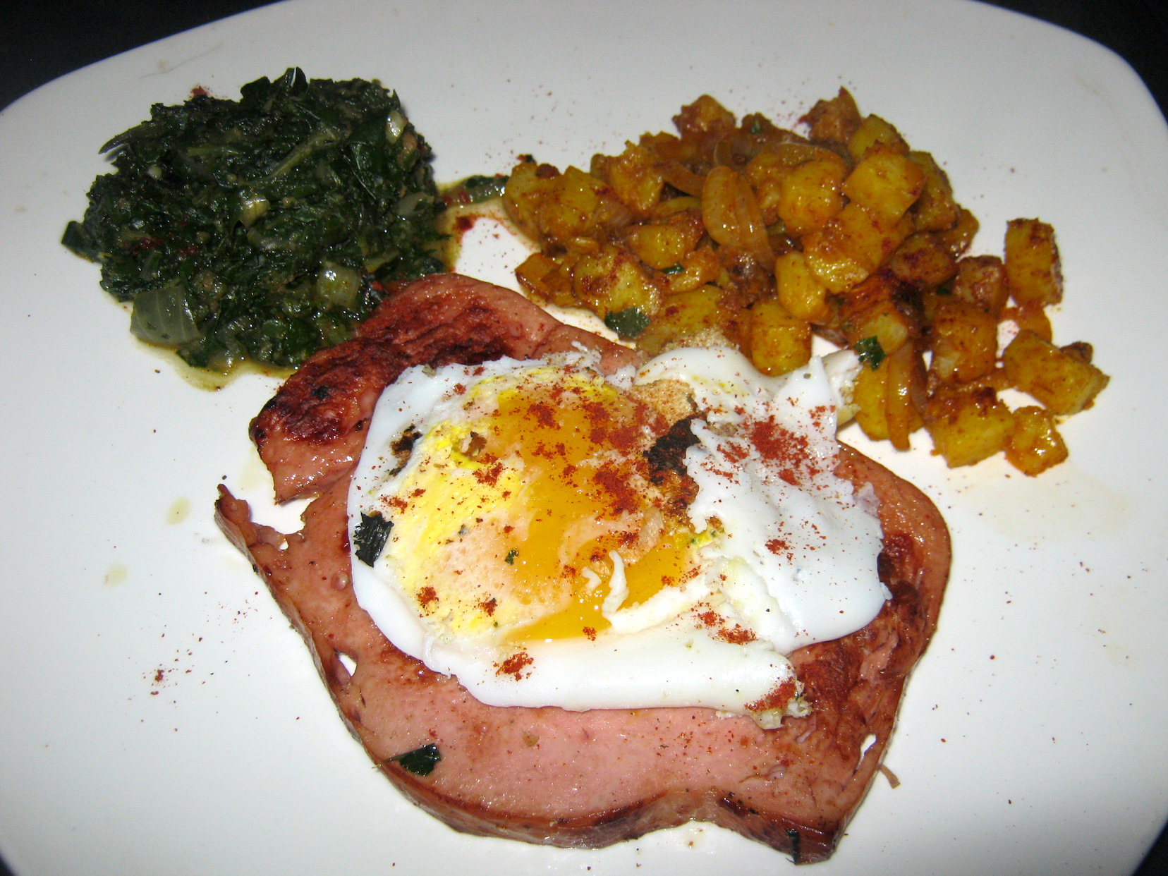 Liver loaf with pan fried eggs and spinach